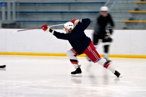 Hockey player takes slap shot
