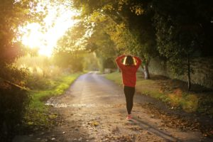 woman walking on a sunlit trail fit more walking into your schedule